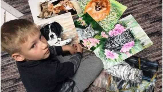 Chłopiec pomaga zbierać karmę i leki dla psów ze schroniska